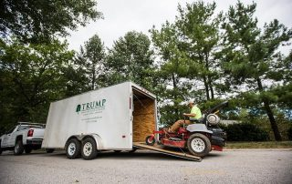 Packing mower into company trailer